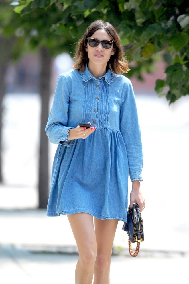 British TV host Alexa Chung dons a short denim smock dress as she strolls in New York's East Village